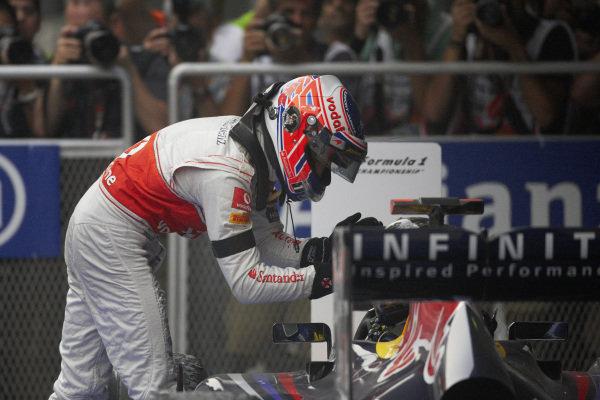 Jenson Button congratulates Sebastian Vettel, Red Bull RB7 Renault, in Parc Ferme.