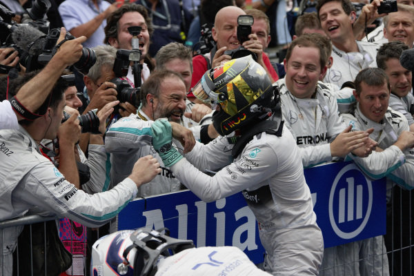 Nico Rosberg hugs mechanics in parc ferme.