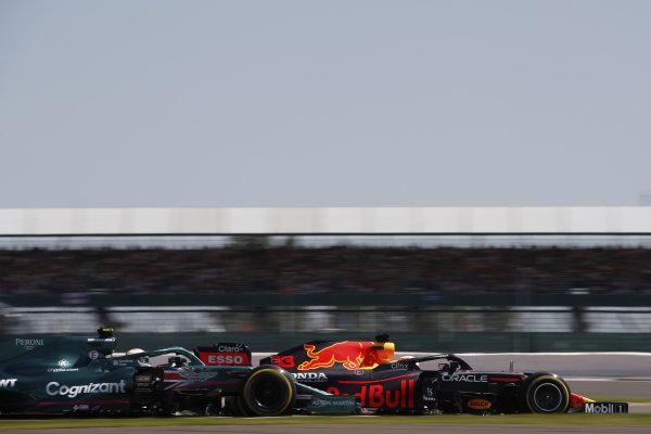 Max Verstappen, Red Bull Racing RB16B, leads Sebastian Vettel, Aston Martin AMR21