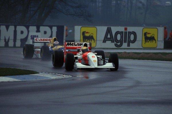 Ayrton Senna, McLaren MP4-8 Ford, leads Alain Prost, Williams FW15C Renault, through the Esses.