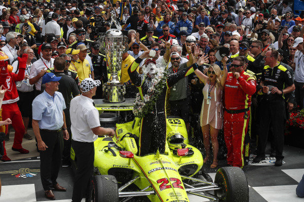 Simon Pagenaud, Team Penske Chevrolet celebrates with the traditional milk in victory lane