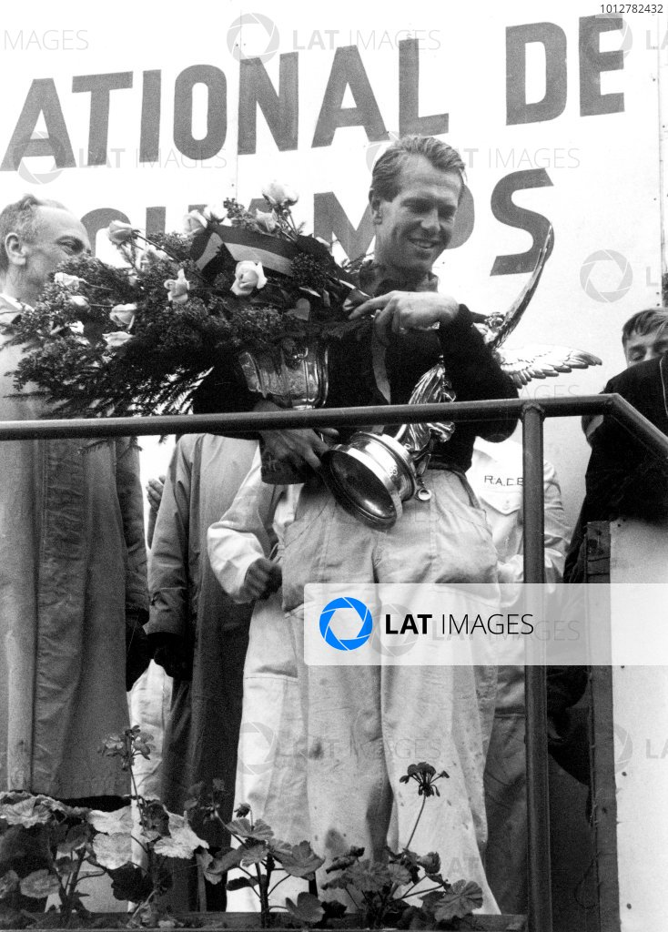 1956 Belgian Grand PrixSpa Francorchamps, Belgium. 1956Race winner Peter Collins (Lancia Ferrari D50 V8), podium.World Copyright: LAT Photographicref: 384/34