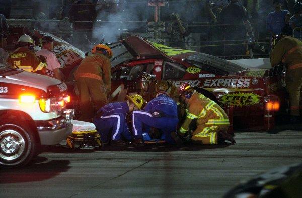 2002 NASCAR,Richmond Intl. Raceway,Sept 06-07, 20022002 NASCAR, Richmond,Va . USA -Emergency crews working on Derrike Cope after a hard hit in BGN action,Copyright-Robt LeSieur2002LAT Photographic