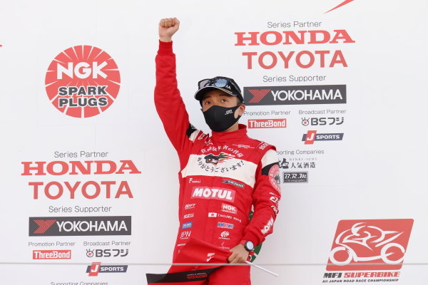Winner Tomoki Nojiri, Team Mugen, Dallara SF19 Honda, celebrates on the podium