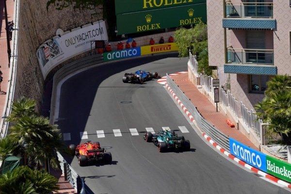 Esteban Ocon, Alpine A521, leads Sebastian Vettel, Aston Martin AMR21, and Charles Leclerc, Ferrari SF21