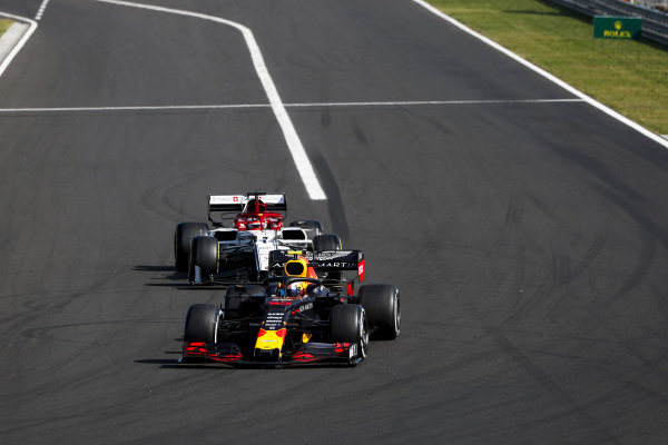 Pierre Gasly, Red Bull Racing RB15, leads Kimi Raikkonen, Alfa Romeo Racing C38