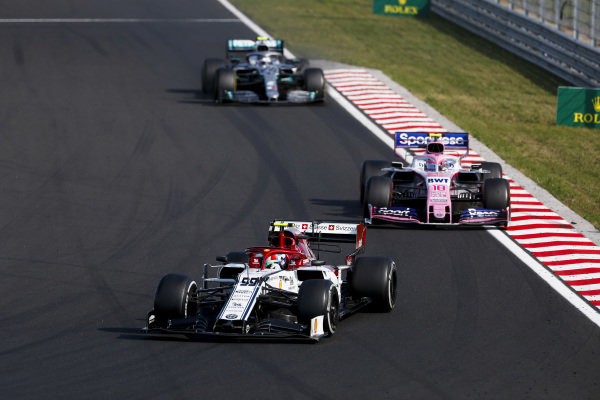 Antonio Giovinazzi, Alfa Romeo Racing C38, leads Lance Stroll, Racing Point RP19, and Valtteri Bottas, Mercedes AMG W10