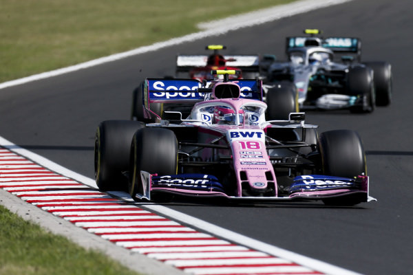 Lance Stroll, Racing Point RP19, leads Antonio Giovinazzi, Alfa Romeo Racing C38, and Valtteri Bottas, Mercedes AMG W10
