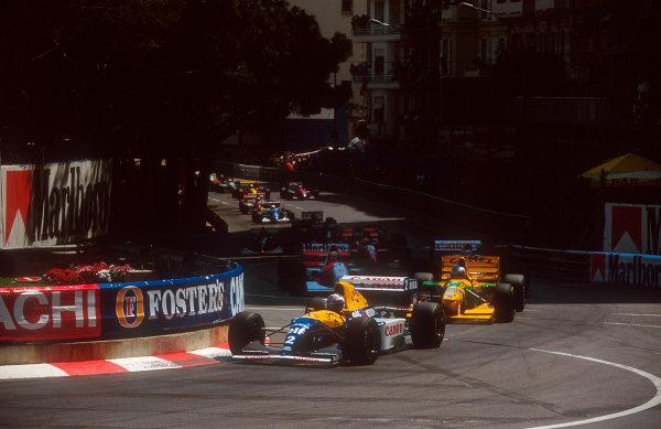 1993 Monaco Grand Prix.Monte Carlo, Monaco.20-23 May 1993.Alain Prost (Williams FW15C Renault) leads Michael Schumacher (Benetton B193B Ford), Damon Hill (Williams FW15C Renault) and Ayrton Senna (McLaren MP4/8 Ford) into Ste. Devote at the start.Ref-93 MON 08.World Copyright - LAT Photographic