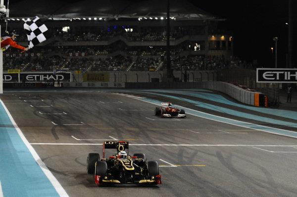 Race winner Kimi Raikkonen (FIN) Lotus E20 takes the chequered flag. Formula One World Championship, Rd18, Abu Dhabi Grand Prix, Race, Yas Marina Circuit, Abu Dhabi, UAE, Sunday 4 November 2012. BEST IMAGE