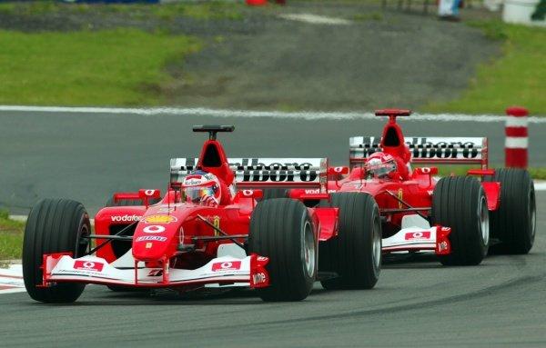 Rubens Barrichello (BRA) Ferrari F2002 leads his team mate Michael Schumacher (GER). European Grand Prix, Nurburgring, Germany, 21 June 2002. DIGITAL IMAGE