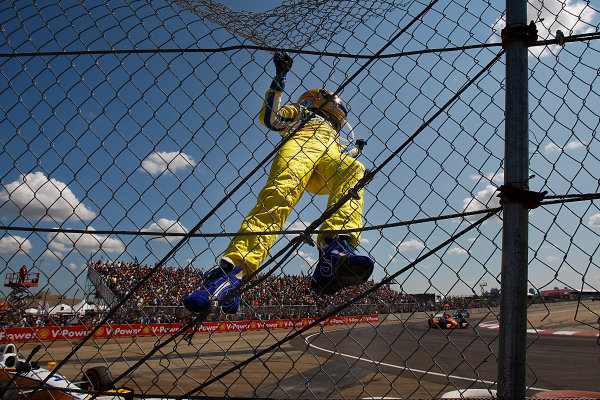 20-22, July, 2012, Edmonton, Alberta, CanadaWinner Helio Castroneves climbs the fence to celebrate his win at the Edmonton Indy(c) 2012, Perry NelsonLAT Photo USA