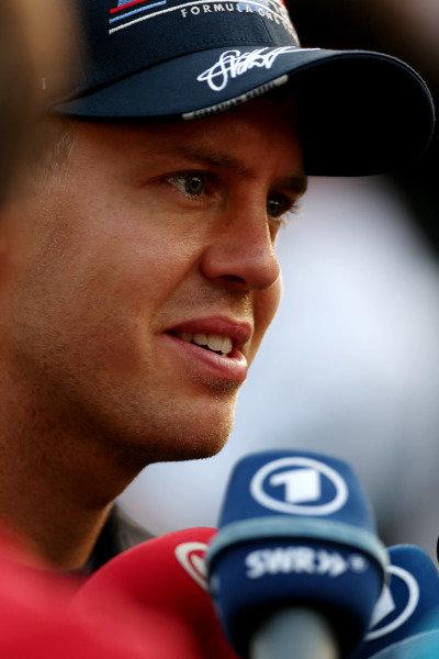 Marina Bay Circuit, Singapore.20th September 2012.Sebastian Vettel, Red Bull Racing, is interviewed.World Copyright: Andy Hone/LAT Photographicref: Digital Image HONZ1101