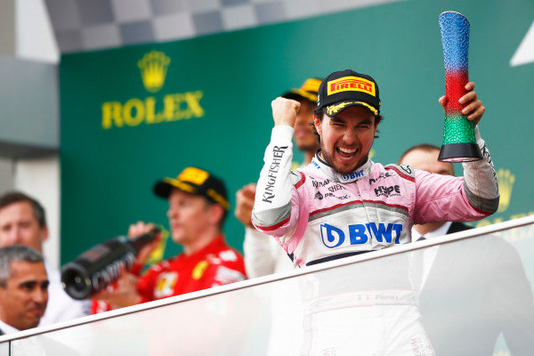 Sergio Perez, Force India, celebrates on the podium.