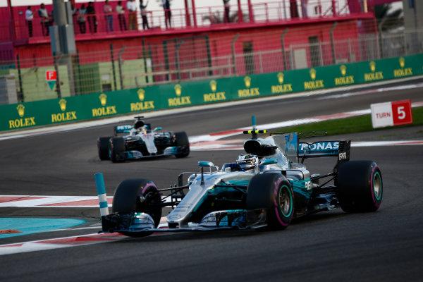 Yas Marina Circuit, Abu Dhabi, United Arab Emirates. Sunday 26 November 2017. Valtteri Bottas, Mercedes F1 W08 EQ Power+, leads Lewis Hamilton, Mercedes F1 W08 EQ Power+. World Copyright:Andy Hone/LAT Images  ref: Digital Image _ONY3660