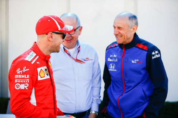 Sebastian Vettel, Ferrari, talks to Franz Tost, Team Principal, Toro Rosso.