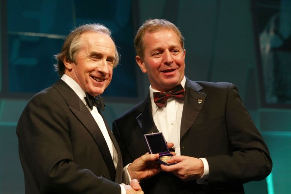 2003 AUTOSPORT AWARDS, The Grosvenor, London. 7th December 2003.Martin Brundle receives a Gold medal from the BRDC.Photo: Peter Spinney/LAT PhotographicRef: Digital Image only