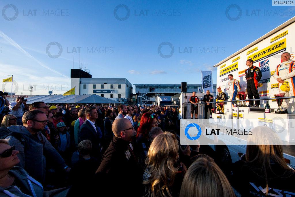 2015 British Touring Car Championship, Silverstone, Northamptonshire, England. 26th - 27th September 2015. Sam Tordoff (GBR) WSR BMW 125i M Sport, 3rd position, Colin Turkington (GBR) Team BMR Volkswagen Passat CC, 1st position, and Rob Collard (GBR) WSR BMW 125i M Sport, 3rd position, on the podium. World Copyright: Zak Mauger/LAT Photographic. ref: Digital Image _MG_3029