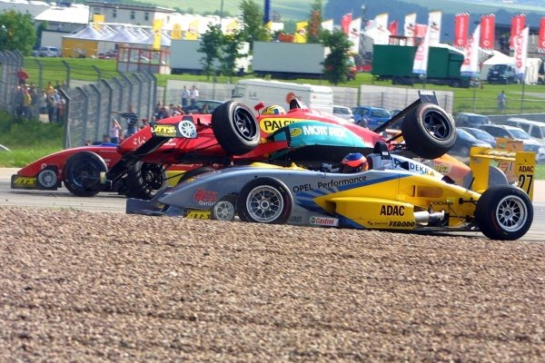 Timo Glock (GER) ends his race in this accident.