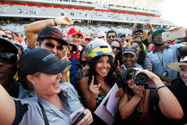 Circuit of the Americas, Austin, Texas, United States of America. Sunday 2 November 2014. Fans celebrate after the race. World Copyright: Charles Coates/LAT Photographic. ref: Digital Image _J5R1470