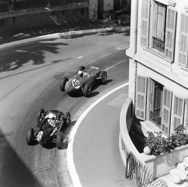 Monte Carlo, Monaco. 10th May 1959.Jean Behra (Ferrari Dino 246), retired, leads Stirling Moss (Cooper T51-Climax), retired, action. World Copyright: LAT Photographic.Ref: 3991.