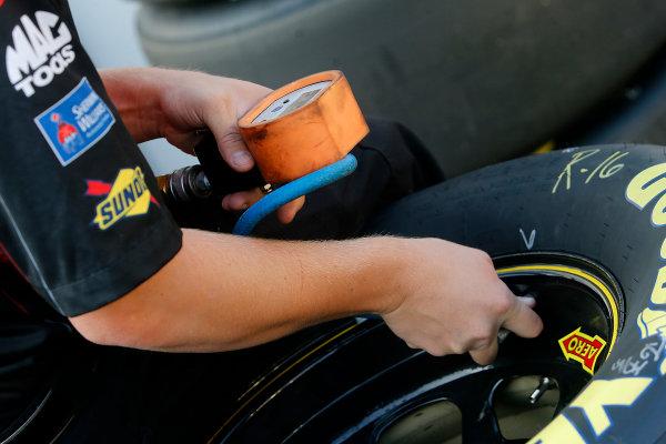 15-17 August, 2014, Brooklyn, Michigan USA Crewman checking tire pressure ©2014, Brett Moist LAT Photo USA