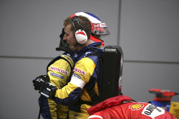 2006 Chinese Grand Prix - Saturday Qualifying Shanghai International Circuit, Shanghai, China. 28th September - 1st October 2006. Rubens Barrichello celebrates 3rd position in qualifying with a team member, portrait, helmet. World Copyright: Charles Coates/LAT Photographic. ref: Digital Image ZK5Y4457