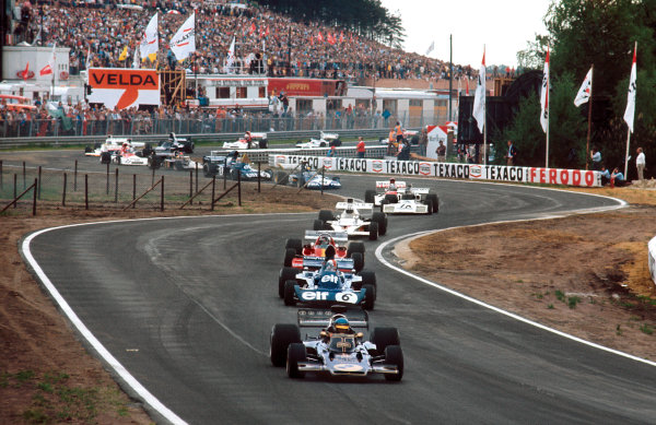 Zolder, Belgium. 18-20 May 1973. Ronnie Peterson (Lotus 72E Ford) leads Francois Cevert  (Tyrrell 006 Ford), Jacky Ickx (Ferrari 312B3), Denny Hulme (McLaren M23 Ford) and Carlos Reutemann (Brabham BT37 Ford) at the start. Ref-73 BEL 71. World Copyright - LAT Photographic