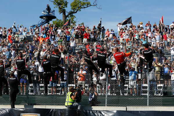 1 June, 2014, Detroit, Michigan, USA Winner Helio Castroneves climbs the fence ©2014, Michael L. Levitt LAT Photo USA