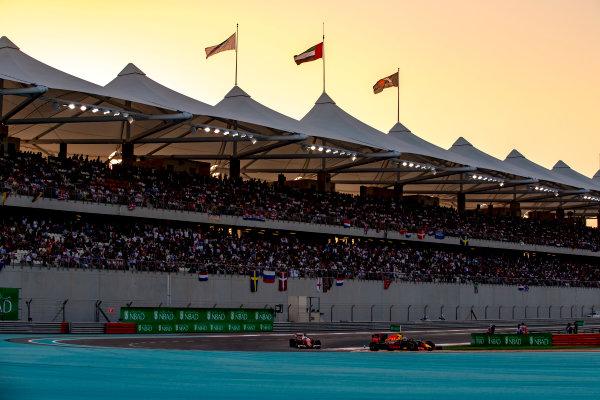 Yas Marina Circuit, Abu Dhabi, United Arab Emirates. Sunday 27 November 2016. Daniel Ricciardo, Red Bull Racing RB12 TAG Heuer, leads Sebastian Vettel, Ferrari SF16-H. World Copyright: Zak Mauger/LAT Photographic ref: Digital Image _X0W9219