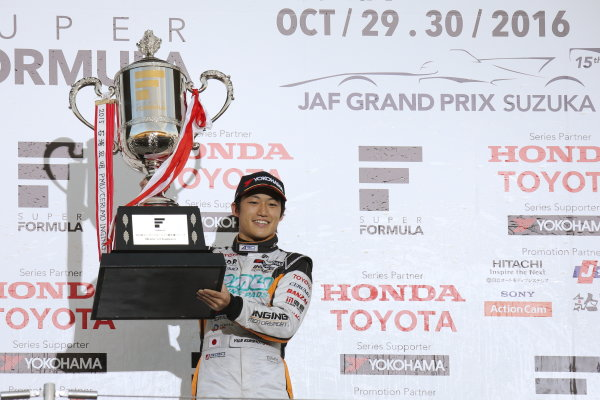 2016 Japanese Super Formula. Suzuka, Japan. 29th - 30th October 2016. Rd 7. Race 2 - 2016 Driver?s Champion Yuji Kunimoto  ( #2 P.MU/CERUMO ? INGING SF14 ) podium, portrait. World Copyright : Yasushi Ishihara / LAT Photographic. Ref : 2016SF_Rd7_SUZUKA_031