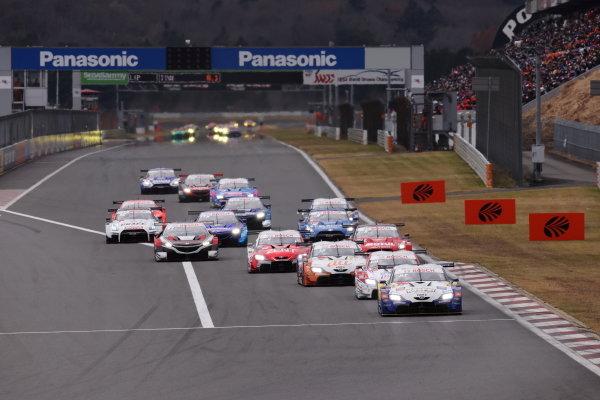 The GT500 cars take the start. The Ryo Hirakawa & Kenta Yamashita #37 KeePer TOM'S Toyota GR Supra leads the pack