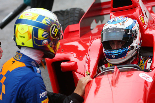 Lando Norris (GBR) and Robbier Kerr (GBR) Ferrari