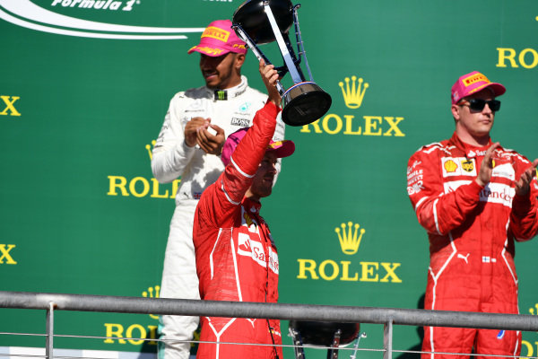 Sebastian Vettel (GER) Ferrari and Kimi Raikkonen (FIN) Ferrari celebrate on the podium with the trophy at Formula One World Championship, Rd17, United States Grand Prix, Race, Circuit of the Americas, Austin, Texas, USA, Sunday 22 October 2017.
