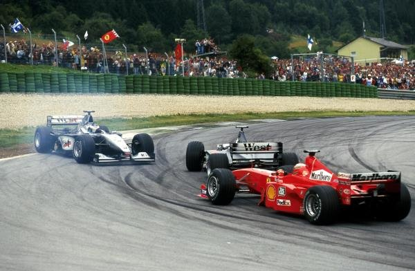 Mika Hakkinen spins after being hit by Team mate David Coulthard