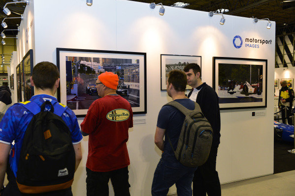 Visitors at the Motorsport Images stand.