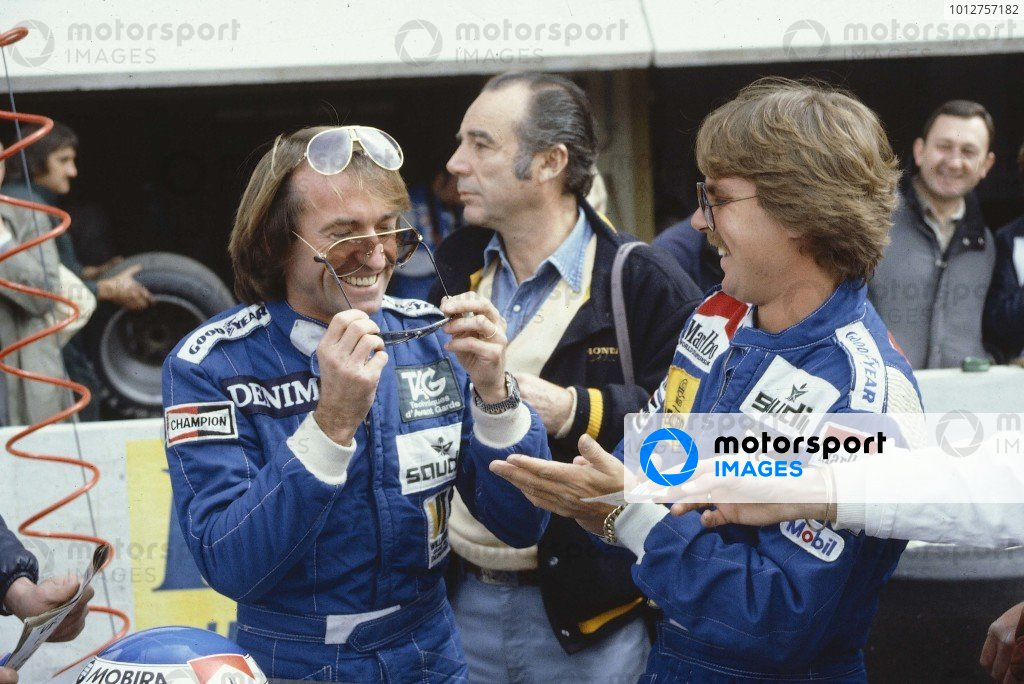 1983 French Grand Prix.Paul Ricard, France.15-17 April 1983.Keke Rosberg watches team mate Jacques Lafitte (Both Williams Ford) try on some sun glasses.Ref-83 FRA 05.World Copyright - LAT Photographic