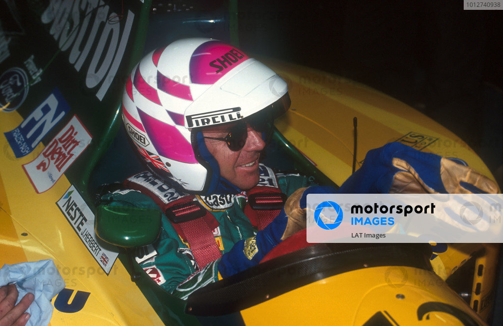 1992 Australian Grand Prix.Adelaide, Australia.6-8 November 1992.Wayne Gardner, the 1987 World 500cc Motorcycle Champion prepares before taking the Lotus 107 Ford out for a two lap drive of the Adelaide circuit on Sunday Morning.Ref-92 AUS 21.World Copyright - LAT Photographic