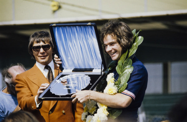 Barry Sheene is presented with a commemorative silver tray for winning the 1976 500cc Motorcycle World Championship.