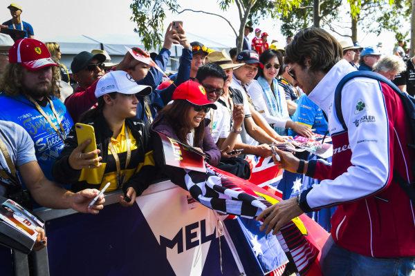 Antonio Giovinazzi, Alfa Romeo Racing signs an autograph for a fan