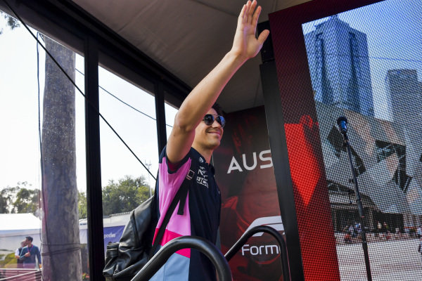 Lance Stroll, Racing Point waves to fans.