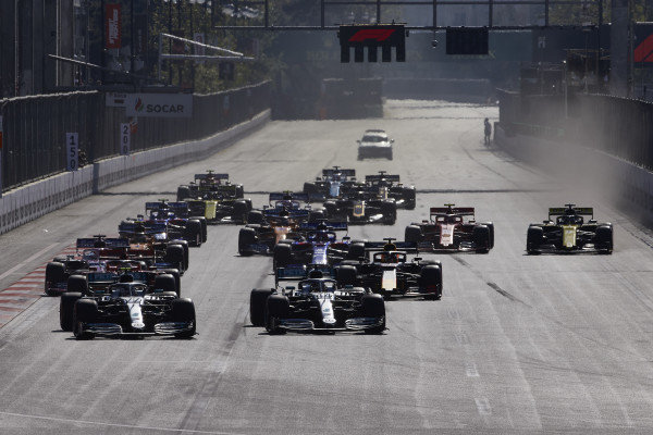 Valtteri Bottas, Mercedes AMG W10, leads Lewis Hamilton, Mercedes AMG F1 W10, Sebastian Vettel, Ferrari SF90, Sergio Perez, Racing Point RP19, Max Verstappen, Red Bull Racing RB15, and the rest of the field at the start
