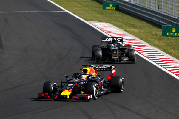 Max Verstappen, Red Bull Racing RB15, leads Romain Grosjean, Haas VF-19