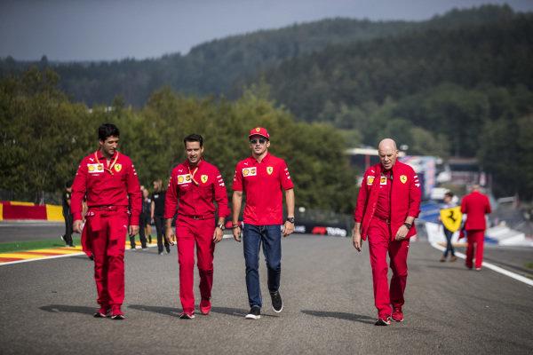 Charles Leclerc, Ferrari, walks the track with colleagues, including Jock Clear, Race Engineer, Ferrari.