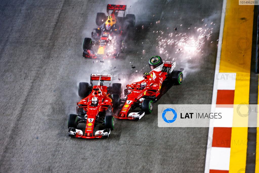 Marina Bay Circuit, Marina Bay, Singapore. Sunday 17 September 2017. Sebastian Vettel, Ferrari SF70H, Max Verstappen, Red Bull Racing RB13 TAG Heuer, and Kimi Raikkonen, Ferrari SF70H, collide at the start. World Copyright: Andy Hone/LAT Images  ref: Digital Image _ONZ7663