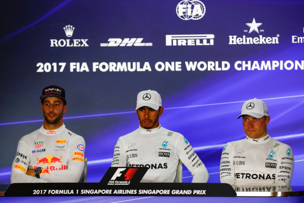 Marina Bay Circuit, Marina Bay, Singapore. Sunday 17 September 2017. Lewis Hamilton, Mercedes AMG, 1st, Daniel Ricciardo, Red Bull Racing, 2nd and Valtteri Bottas, Mercedes AMG, 3rd, in the post race press conference. World Copyright: Sam Bloxham/LAT Images  ref: Digital Image _J6I8231