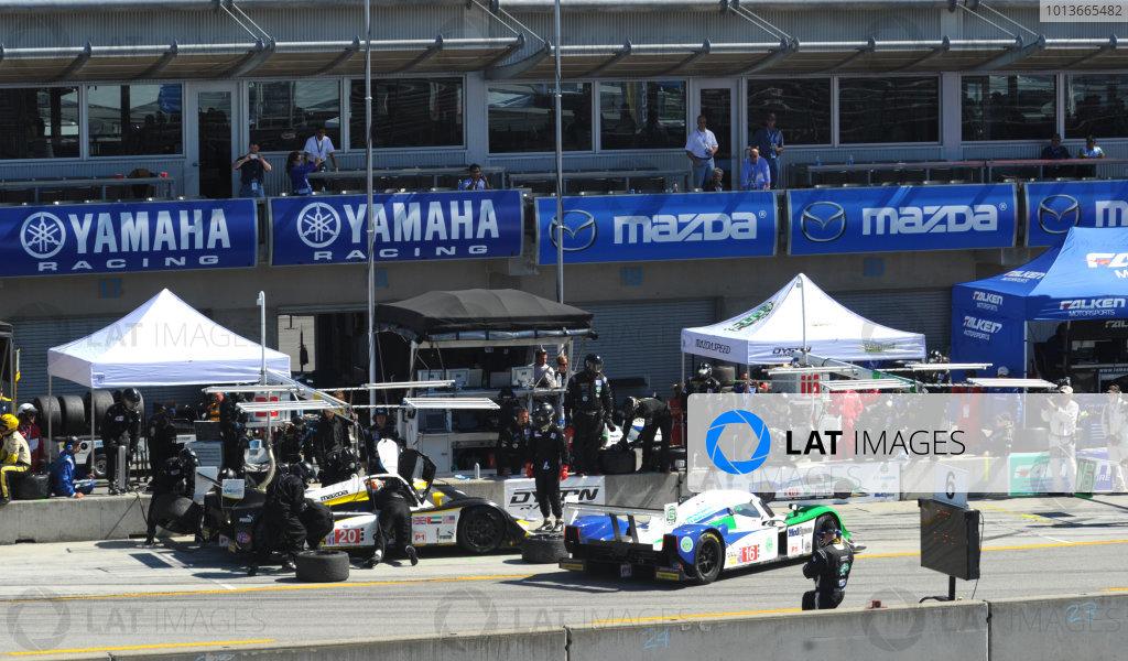 16-18 September, 2011, Monterey, California USA#16 Dyson Racing Team Mazda Lola B09/86 entering pitbox as #20 Lola during pitstop(c)2011,  Dan R. Boyd  LAT Photo USA