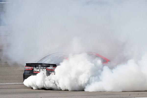 2017 Monster Energy NASCAR Cup Series - Kobalt 400 Las Vegas Motor Speedway - Las Vegas, NV USA Sunday 12 March 2017 Martin Truex Jr, Bass Pro Shops/TRACKER BOATS Toyota Camry celebrates his win with a burnout World Copyright: Nigel Kinrade/LAT Images ref: Digital Image 17LAS1nk07768