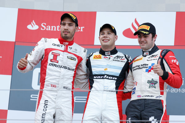 2013 GP3 Series. Round 4.  Nurburgring, Germany.  6th July 2013.  Saturday Race. Facu Regalia (ARG, ART Grand Prix) celebrates his victory on the podium with Tio Ellinas (CYP, Marussia Manor Racing) and Jack Harvey (GBR, ART Grand Prix). World Copyright: Alastair Staley/GP2 Series Media Service. Ref: _R6T7290