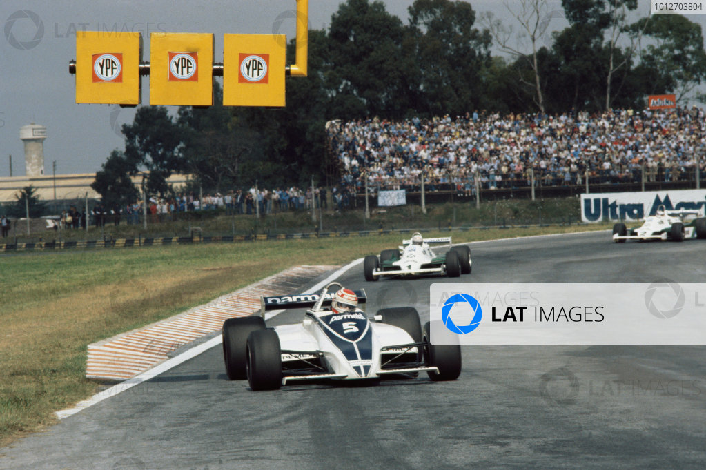 Buenos Aires, Argentina. 10-12 April 1981.Nelson Piquet (Brabham BT49C-Ford Cosworth), 1st position, leads Alan Jones (Williams FW07C-Ford Cosworth), 4th position.World Copyright: LAT PhotographicRef: 35mm transparency.